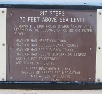 a sign explaining heath problems that should preclude one from walking the lighthouse stairs